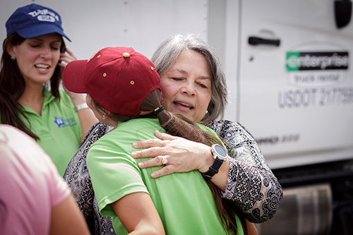 Angelina Castillo Kelley, a housing manager for a Key West Housing Authority residence for senior citizens, thanks volunteers from throughout the Archdiocese of Miami who delivered a caravan of emergency supplies Sept. 26 to locations throughout the Florida Keys as that region recovers from Hurricane Irma.