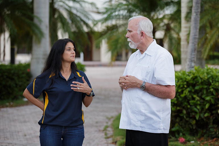 Kathy Mesa, a member of St. John Neumann Parish in Miami, speaks with Father Stephen Hilley, pastor of St. Justin Martyr Parish in Key Largo, during a distribution of post-hurricane supplies. Volunteers from throughout the Archdiocese of Miami delivered a caravan of emergency supplies Sept. 26 to locations throughout the Florida Keys as that region recovers from Hurricane Irma.