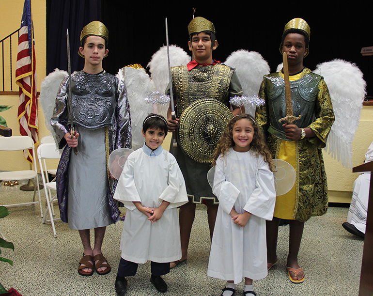 Angels and archangels, from left, Gabriel, Michael and Raphael, represented by St. Michael School eighth graders and kindergarten students.