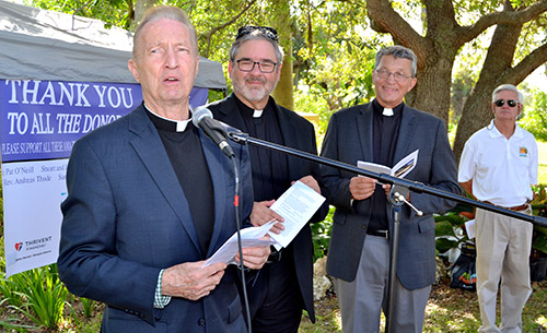 Father Pat O'Neill, at the microphone, introduces the dedicatory prayer for the new labyrinth at MorningStar Renewal Center. Next to him, from left, are Lutheran ministers Walter Still and John Mocko, and Commissioner James McDonald of Pinecrest.