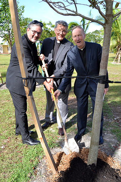 Lutheran and Catholic ministers help to dedicate a mahogany tree during the dedication of the new labyrinth at MorningStar Renewal Center in Pinecrest. From left are ministers Walter Still and John Mocko of the Evangelical Lutheran Church in America, and Father Pat O'Neill of the archdiocese.