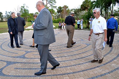 Worshipers do a prayerful walk of the labyrinth after its dedication at MorningStar Renewal Center.