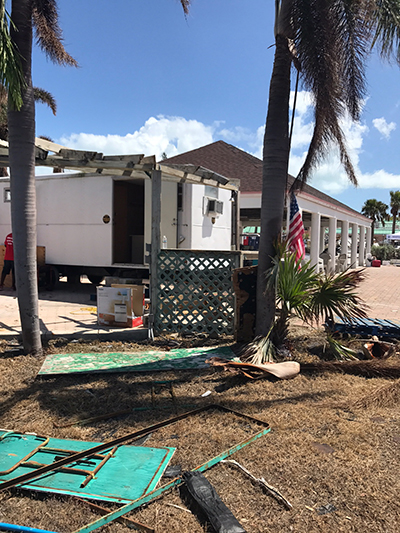Catholic Charities delivered and installed a trailer Oct. 3 at St. Peter the Fisherman Parish in Big Pine Key to serve as a temporary sacristy and food pantry. (COURTESY PHOTO)