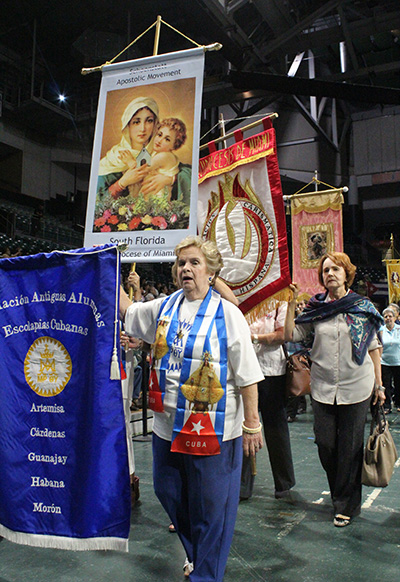 Members of various archdiocesan movements process with banners of their groups.