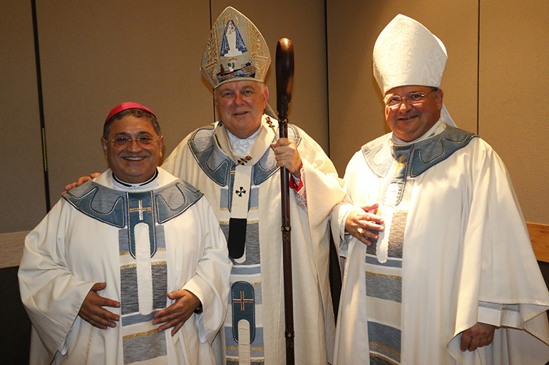 Archbishop Thomas Wenski poses with his auxiliary bishops, Bishop Peter Baldacchino (left) and newly appointed bishop-elect Enrique Delgado.