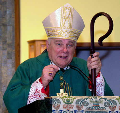 Archbishop Thomas Wenski, during the kickoff Mass for St. Helen Church's 50th anniversary, urges his listeners to stretch even more to welcome people to church.