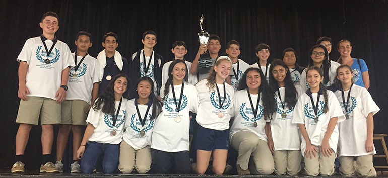St. Bonaventure School students hold up their Maverick Traveling Cup after winning the 2017 academic competition hosted by Archbishop Edward McCarthy High School.