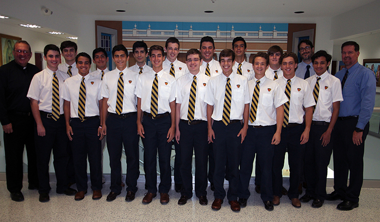 These are the 2017 National Merit Commended students at Belen Jesuit posing with the school's president, Jesuit Father Guillermo García-Tuñón, far left, Ramón Nicosia, assistant principal to the high school (back), and José Roca, school principal.