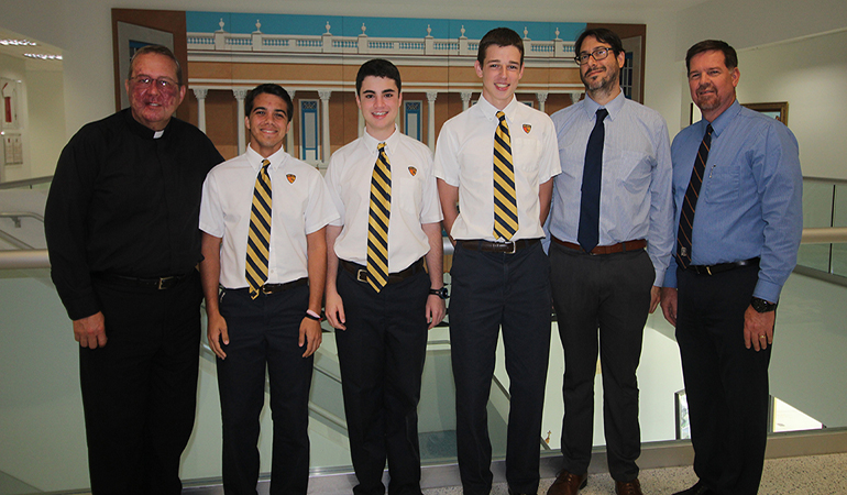 These are the 2017 National Merit Semifinalists at Belen Jesuit, posing with the school's president, Jesuit Father Guillermo García-Tuñón, far left, Ramón Nicosia, assistant principal to the high school, and José Roca, school principal, far right.