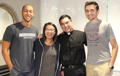 UCatholics Angel Carrasco, Trish Vega and Adam Wahl stop by to visit Father Phillip Tran during the school day at the UM Catholic campus ministry suite in Pentland House.