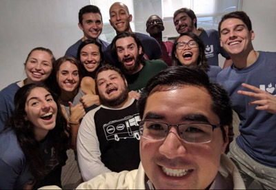 Father Phillip Tran takes one of his first selfies as UM Catholic Campus Minister with some of his UCatholics in their new UM Catholic campus ministry suite in Pentland House at the University of Miami.