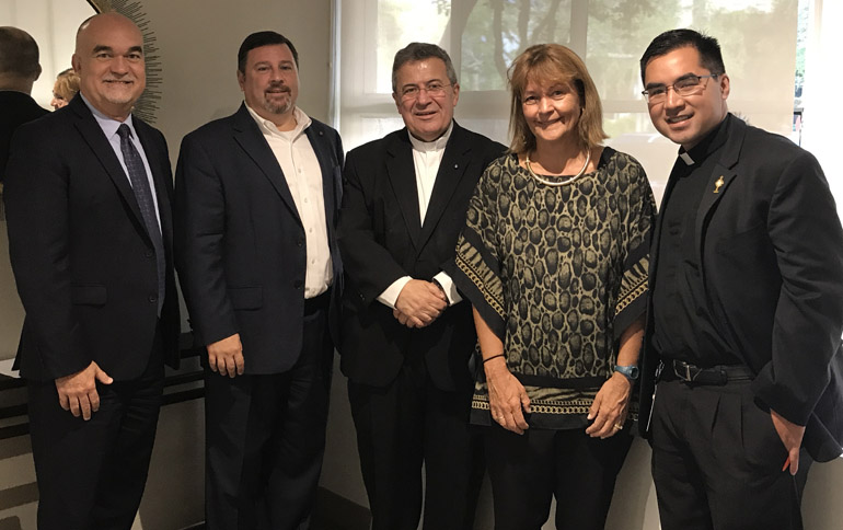 UM Catholic campus ministry suite in Pentland House at the University of Miami receives a visit from (left to right) Gilbert Arias, Assistant Vice President of Facilities for the University of Miami, Stephen Colella, archdiocesan cabinet secretary for parish life, Msgr. Tomas Marin, pastor of St. Augustine Church, Patricia Whitely, vice president of student affairs at the University of Miami, and Father Phillip Tran, Catholic Campus Minister at the University of Miami. The Archdiocese of Miami and the University of Miami collaborated in the efforts to establish a space and a priest on campus for Catholics.