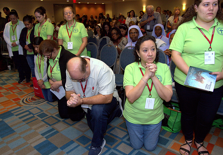 Teachers from St. Martin de Porres Church pray during the 2017 Archdiocesan Catechetical Conference.