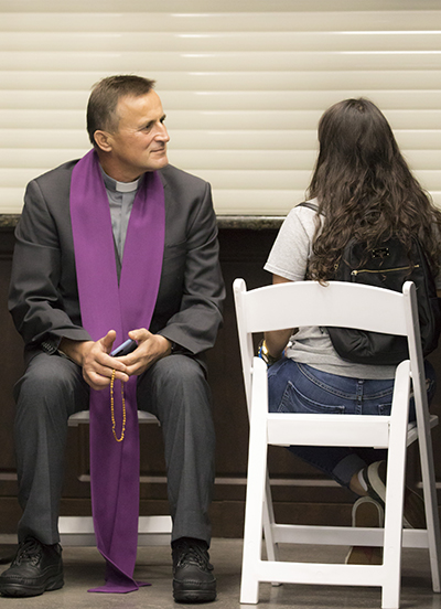 Redemptorist Father John Juszczak listens to confessions at the start of the 2017 Mercy Night.