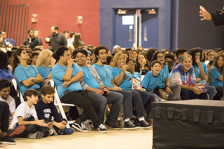 Students react to keynote speaker Father Tony Ricard, pastor of St. Gabriel the Archangel and campus minister/theology teacher at St. Augustine High School in the Archdiocese of New Orleans.  Approximately 700 teenagers attended Mercy Night 2017 at St. Thomas University in Miami Gardens.