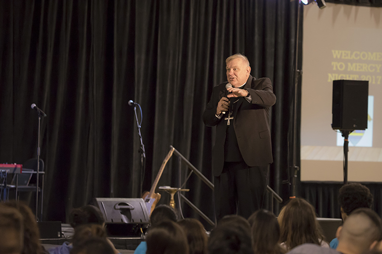 Archbishop Thomas Wenski speaks to the hundreds of youths attending the 2017 Mercy Night. The celebration took place at St. Thomas University in Miami Gardens.