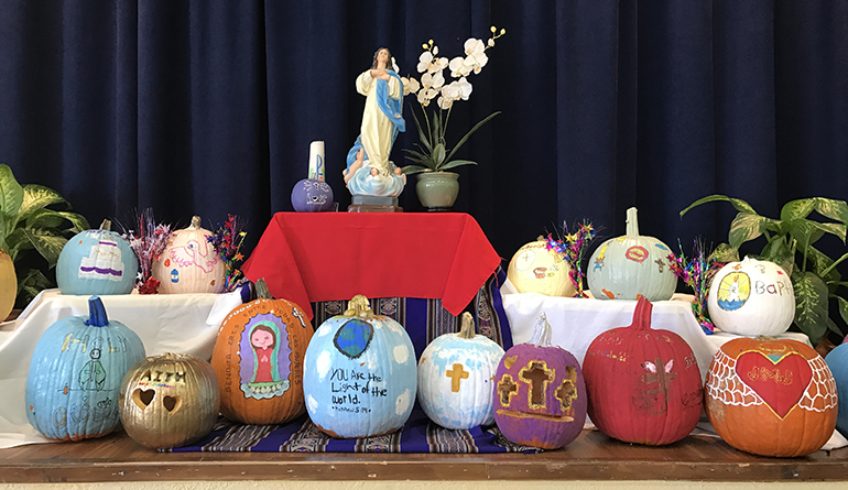 The Light of the World pumpkin submissions displayed during the feast of All Saints Day at St. Michael School.