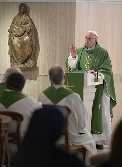 Pope Francis celebrates morning Mass in Santa Marta. As part of a series of Wednesday teachings on the Eucharist, he said Nov. 15 at his general audience that the time before the start of Mass should be spent in silent prayer, not