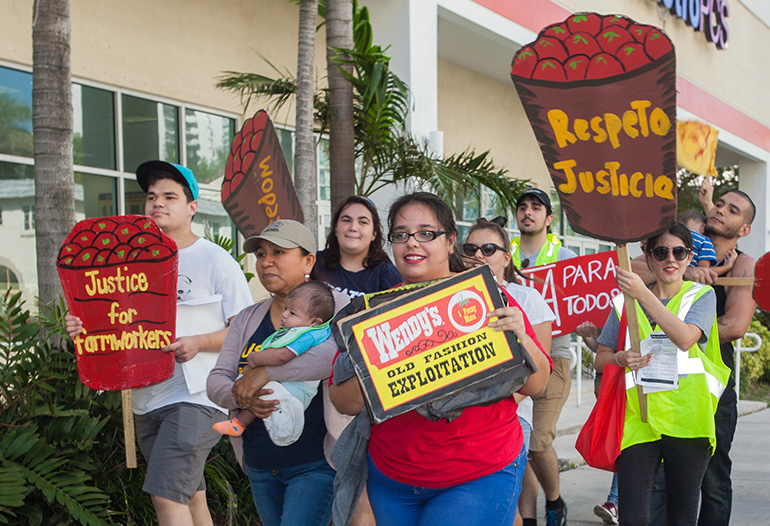 St. Thomas University and Barry University students joined members and supporters of the Coalition of Immokalee Farmworkers at the fourth annual March for Fair Food in downtown Miami Nov. 11. They walked to a Wendy's and a Publix, corporations that do not participate in the Fair Food Program.