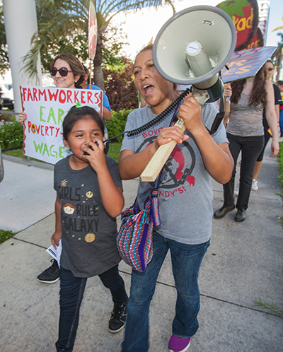 Daisy Vasquez, 8, leads protest chants as Silvia Perez holds the megaphone during the March for Fair Food Nov. 11.
