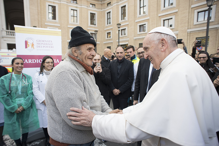 The pope makes a surprise visit Nov. 16 to a makeshift medical center in front of St. Peter's Square where poor and homeless people are receiving free treatment ahead of the Nov. 19 World Day of the Poor.
