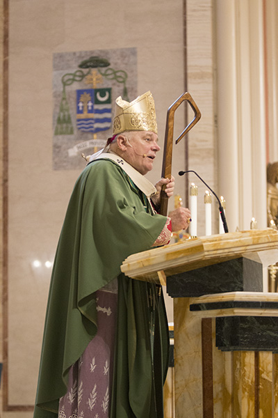 Archbishop Thomas Wenski preaches the homily at the annual ThanksForGiving Mass Nov. 19, thanking all the donors to ABCD, honoring three families with the One in Faith, One in Hope and One in Charity award and inducting new members into the Archbishop Coleman Carroll Legacy Society.