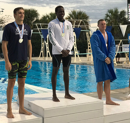 St. Brendan's Irvin Hoost, center, won the 50-yard freestyle to help St. Brendan finish 20th with 35 points in the Class 2A state swim meet. Hoost also took fourth in the 100-yard freestyle in 46.04.