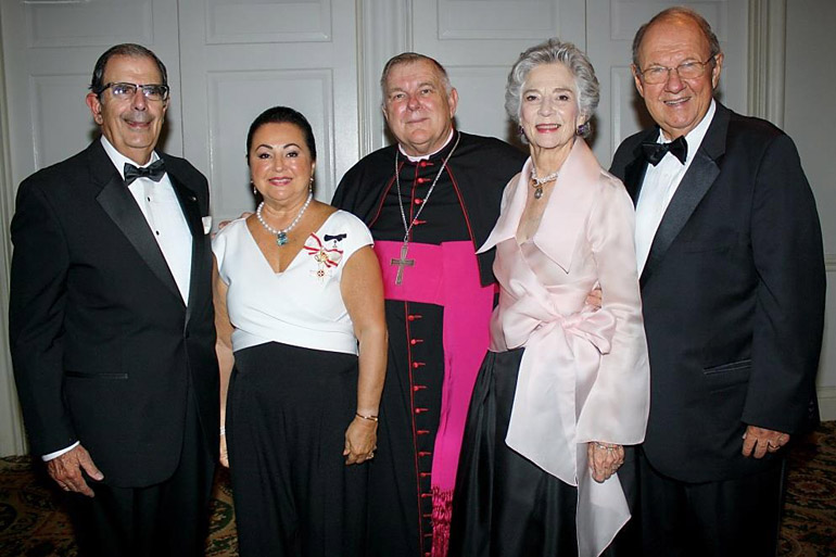 Celebrating the White Cross Gala with the Cuban Association of the Knights of Malta, from left, are the association's president, Juan Jose Calvo y de Dios; Maria Cristina Diaz, who was awarded the Order of Merito Melitense that evening for her work as Gala Committee Coordinator for the past 12 years; Archbishop Thomas Wenski; and Christine de Marcellus de Vollmer, recipient of this year's Tuitio Fidei award, accompanied by Manolo Diaz.