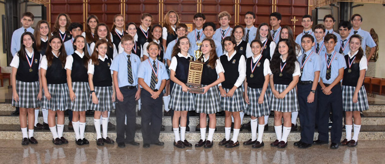 Scholastic students athletes from Epiphany School pose with the medals and first place trophy they won at the 39th annual Christopher Columbus Scholastic Olympics.