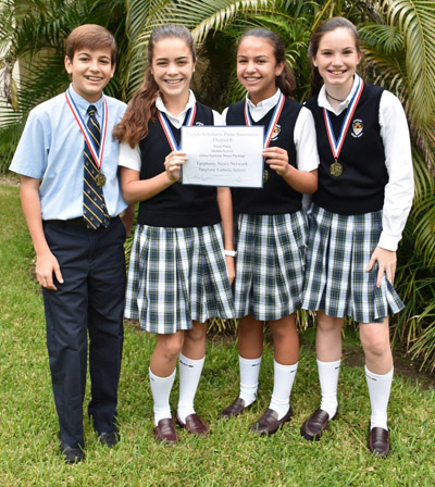 Epiphany eighth graders who produced a gold medal-winning news package on Miami-Dade Animal Services pose with their awards. The team also won first place at the Florida Scholastic Press Association Fall Workshop.