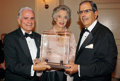 Christine de Marcellus de Vollmer receives this year's Tuitio Fidei award at the Cuban Association of the Order of Malta's 12th annual White Cross Gala. Pictured are Gala Host Committee Chairman Fernando Garcia-Chacon y Chacon, left, and Association President Juan Jose Calvo y de Dios.