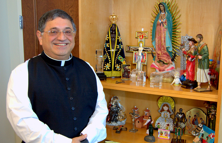 Bishop-elect Enrique Delgado likes to collect mementoes from mission trips he's led abroad.