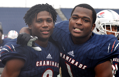 Chaminade-Madonna defenders Te'Cory Couch, left, and Keontra Smith celebrate a Lions touchdown in the second half of Chaminade-Madonna's 31-28 victory over the West Palm Beach Oxbridge Academy ThunderWolves at the Class 3A FHSAA Football Final.