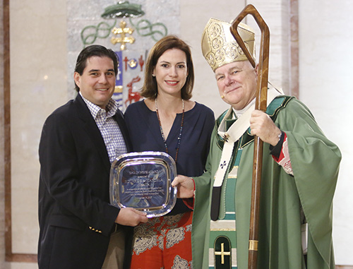 Eduardo and Marcela Eraña of St. Agnes Church in Key Biscayne receive the 2017 One in Hope award from Archbishop Thomas Wenski.