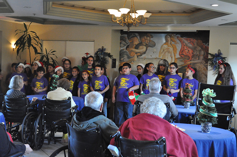 student members of the mission club at st michael school sing christmas carols to floridian