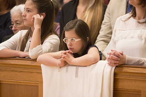 Mia Rodicio, 9, niece of Deacon Sergio Rodicio, watches intently during the Litany of the Saints.