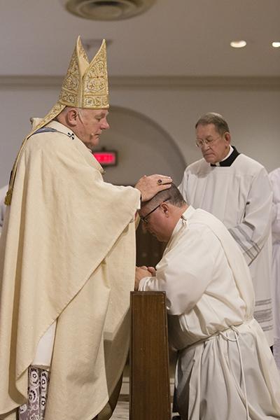 Archbishop Thomas Wenski ordains William Bertot of Gesu Church to the permanent deaconate.