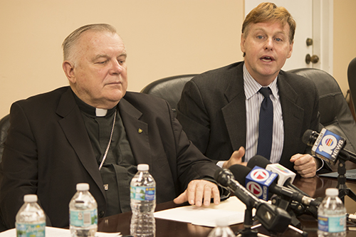 Randolph McGrorty, CEO of Catholic Legal Services of the Archdiocese of Miami, speaks to the press Nov. 22 regarding the termination of TPS for Haitians. Next to him is Archbishop Thomas Wenski.