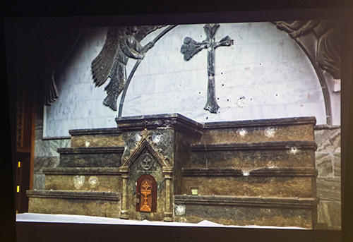 The bullet-ridden sanctuary of a Mosul church is shown during a slide presentation by Father Benedict Kiely, who spoke Dec. 11, 2017 at St. Agnes Church, Key Biscayne, about the persecution of Christians in the Middle East.