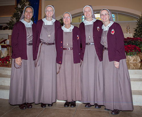The newly professed sisters pose with their superior, Mother Adela Galindo, center, foundress of the Servants of the Pierced Hearts of Jesus and Mary, after the ceremony. From left: Sister Alexia Maria Zaldivar-Boillat, Sister Brittany Rose Samuelson, Sister Mary Rachel Hart, and Sister Clare Marie Bailey.