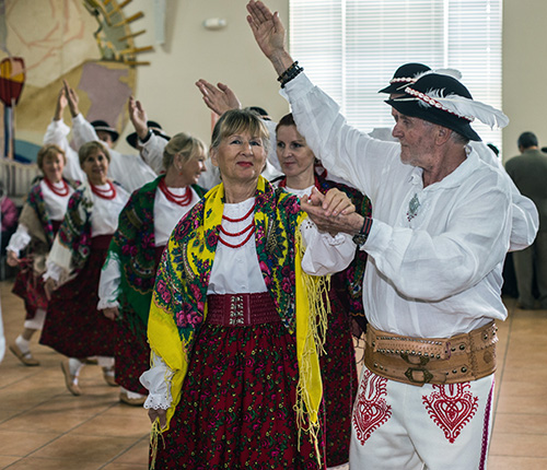 Members of the Polish Apostolate dance the Polonez at reception after Mass.