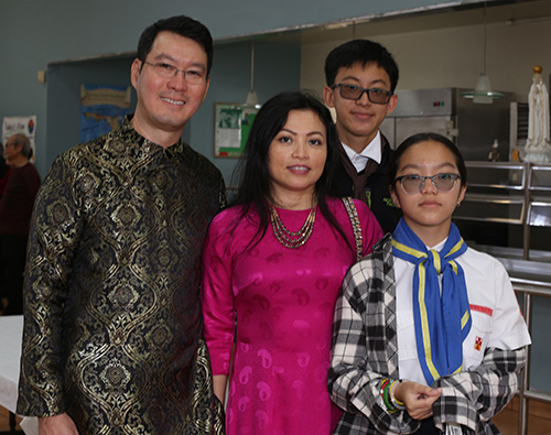 Khoa Mguyem poses with his family at the reception that followed the Migration Mass: wife Doan, son Kenneth and daughter Lindsey.