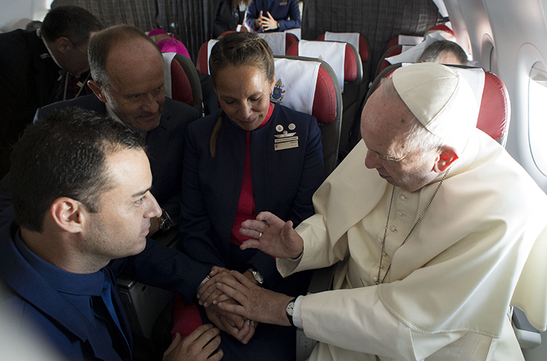 Pope Francis marries flight attendants Paula Podesta and Carlos Ciuffardi during his flight from Santiago to Iquique Jan. 18, 2018.
