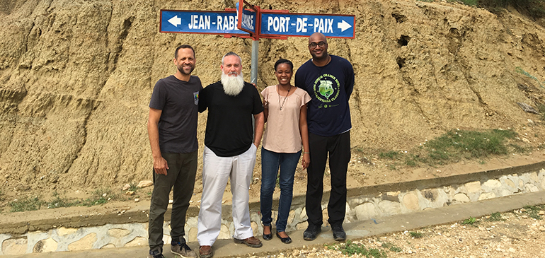Msgr. Pace High's missionary teachers pose at a crossroads in Haiti. From left are Andres Novela, Marcel Navarro, Pascale Reseau and Courtney Bloom.