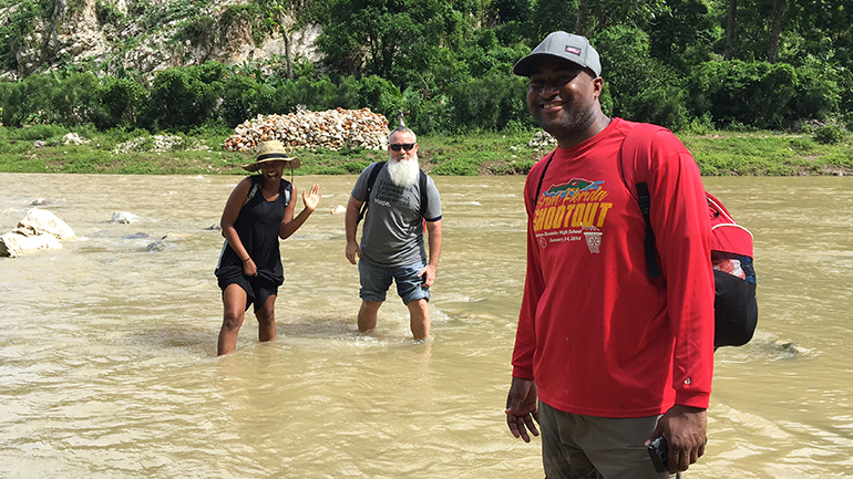 Rising waters did not stop Pace's missionary teachers, Pascale Reseau, Marcel Navarro and Courtney Bloom, from crossing a river in Haiti.