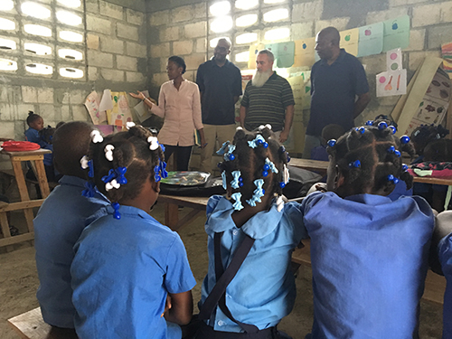 Students in Haiti listen to Pace teachers, from left, Pascale Reseau, Courtney Bloom and Marcel Navarro. Reseau, who grew up in Haiti, felt nostalgic being back in the classrooms.