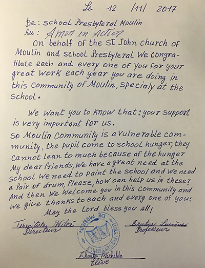 A letter of thanks and plea for assistance is presented to missionary teachers and Amor en Accion, the official missionary organization of the Archdiocese of Miami.