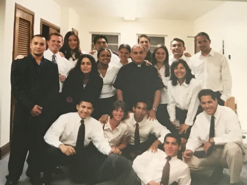Father Oscar Sarmiento is seen here with the young adult choir from St. Joseph Church, Miami Beach. At weekly meetings, he taught and formed the young adults until they became servants and retreat leaders for the whole parish.