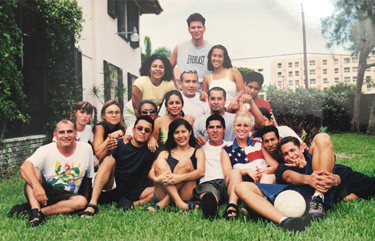 Father Oscar Sarmiento is seen here, seated at far left, with the young adult group from St. Joseph Church, Miami Beach, during one of their retreats.