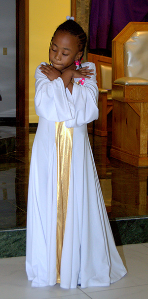 A member of the Mbofro Ne Nyame Dancers takes part in the black Catholic revival at St. Helen Church, Lauderdale Lakes.